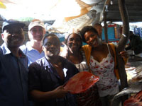 (Left to right) Mr Rui Mutombene (Mozambique IIP collaborator), Ms Christine Coppinger (MSc Student) and local fish market sellers in Maputo fish market in Mozambique